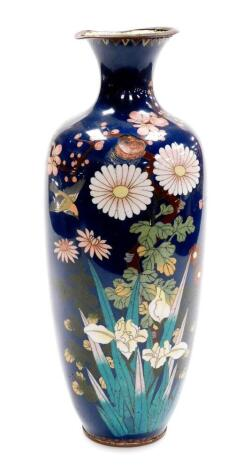 A Meiji period Japanese cloisonne baluster vase, decorated with flowers on a blue ground, 35cm high. (AF)