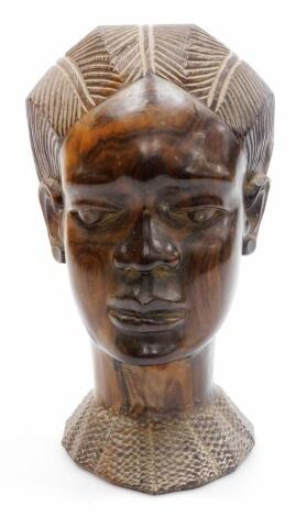 A 20thC African tribal head formed as a lady, with elaborate hair and heavily carved neckline, 24cm high.