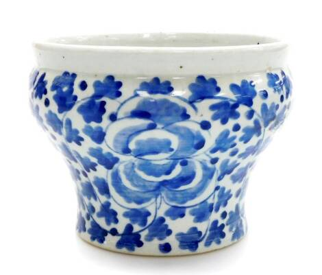 A late 19thC Chinese blue and white jardiniere, of waisted form painted with flowers and leaves, 20.5cm diameter, 15cm high.