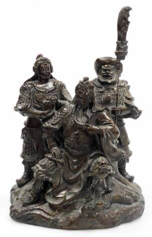 A Chinese bronzed spelter figural group, of a seated bearded general with two attendants on a rock work base, unmarked, 19thC, 37cm high.
