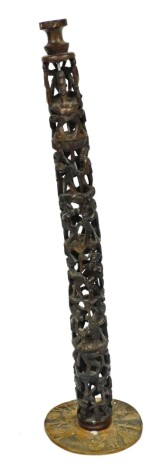 A 20thC African tribal carved pillar, of four sections formed as many figures with elaborate hair and clothing, on turned point stems, terminating on a carved round base, 85cm high.