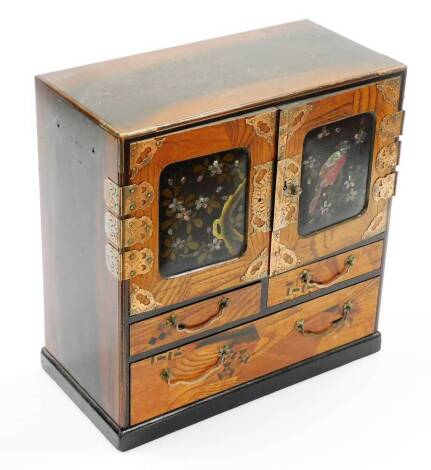 A Japanese Meiji period parquetry and lacquer table cabinet, with two doors opening to reveal six drawers, all above two short and one long drawer and on a plinth base, 29cm high, 30cm wide, 14.5cm deep.