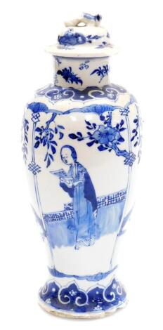 A Chinese blue and white porcelain baluster jar and cover, decorated with panels of women alternating with birds of birds and flowering branches, pseudo four character Kangxi mark to base, 28cm high.