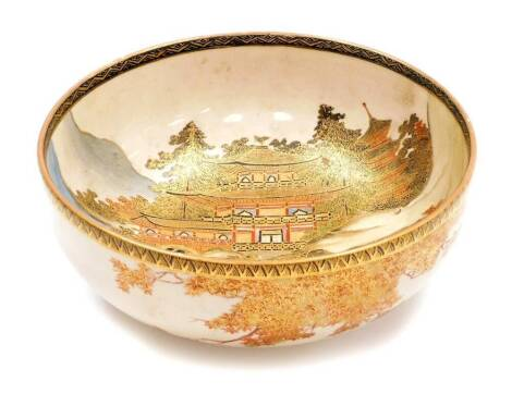A Japanese Satsuma bowl, decorated with women walking in front of The Golden Pavilion in Kyoto, the exterior with irises, chrysanthemums and maple foot, the base signed Hakuzan, Meiji period, 18cm diameter.