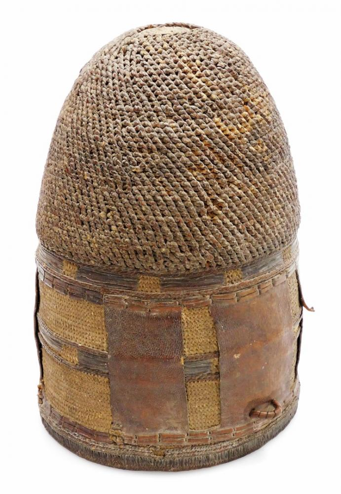 A 20thC African tribal dome, with leather insert and entwined woven top...
