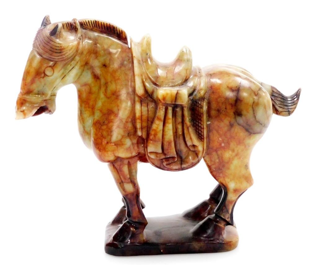 A 20thC soapstone Tang style figure of a standing horse, on shaped base...