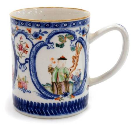 A Chinese export porcelain mug, decorated with blue cartouches containing coloured enamelled figures, the background with floral sprays between diaper and arrowhead bands, unglazed base, 18thC, 14cm high.