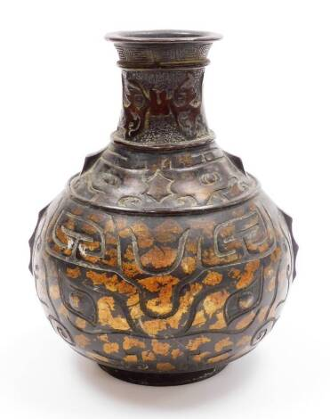 A 20thC metal vase, with compressed cylindrical stem, studded and raised with stylised animals, the globular raised and set with various geometric patterns, on a circular foot with gilt highlights, 23cm high.