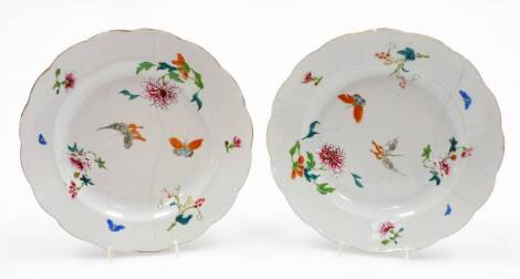 A pair of 18thC Chinese porcelain plates, each decorated in polychrome enamels with butterflies and flowers, 23cm wide. (2, AF)
