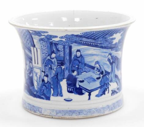 A large Chinese blue and white porcelain brushpot, of waisted form decorated with a continuous scene of scholars playing a game of go while attendants look on, further adult figures and children playing in the garden, Greek key fret border at the base; Ka