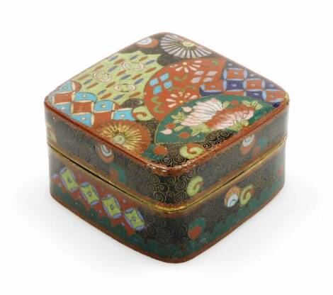 A 20thC Japanese cloisonne box and cover, profusely decorated with flowers in orange, blue, black and green, Meiji period, 7cm wide.