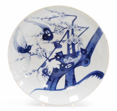 A Chinese provincial porcelain dish, decorated with birds and flowering trees, 28cm diameter. (AF)
