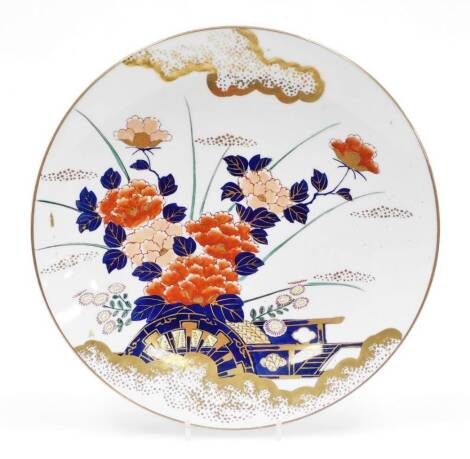 A late 20thC Japanese charger, in an Imari style palette, decorated with flowers with gilt highlights, marked to base, 37cm diameter.