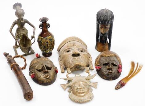 A group of tribal art, comprising a metal face mask, with elaborate head dress set with exotic birds, the figure head quarter profile with elaborate neck, 19cm high, various African tribal carved masks, figure holding basket, Oriental vase with raised met