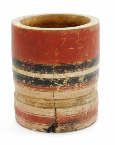 An African tribal jar, painted with a red and black banding, with plain interior, 18cm high.