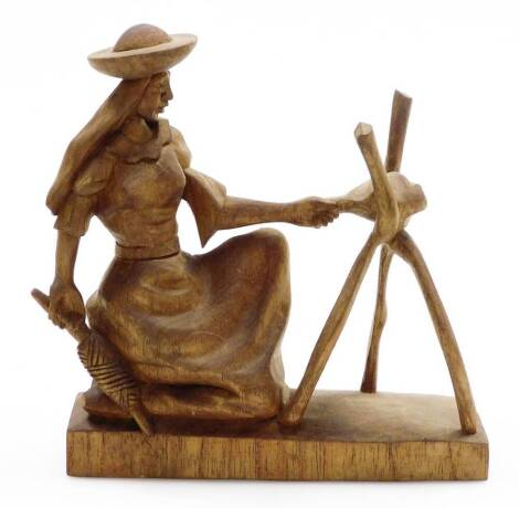 A heavily carved figure group, of a lady in flowing robes holding double ended knife, on plain base, unmarked, 21cm high.
