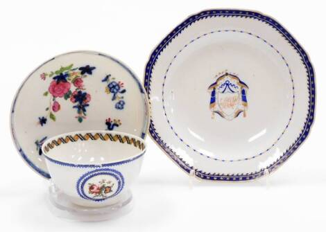 A group of 18thC and later porcelain, comprising an export monogrammed saucer, with central shield picked out in gilt, with an outer bluer border decorated with stars, 15cm wide, an export porcelain tea bowl, decorated with flowers, and an associated sauc