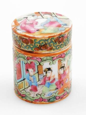 A 19thC Canton famille rose cylindrical jar and cover, the lid decorated with figures in an interior setting, the main body decorated with panels of birds, insects and flowers and further interior scenes, 7cm high.