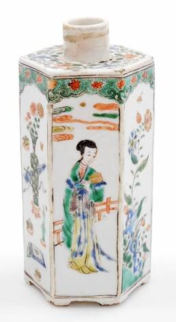 A Chinese porcelain hexagonal tea caddy, decorated with panels of vases and figures beside a fence, decorated in famille verte palette, unglazed base, 18thC, 18cm high.