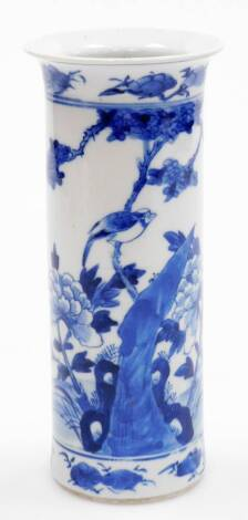 A Chinese blue and white porcelain cylinder vase, decorated with bird perched on a peony branch emerging from rockwork, double circle line to base, 19thC, 21cm high.