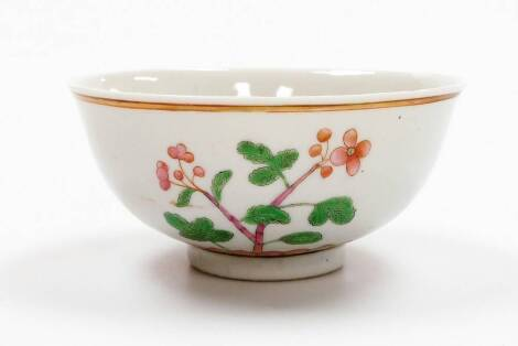 A Chinese porcelain bowl decorated in green and pink enamels, with flowering branches above a lotus petal border, double circle six character Kangxi mark, 19thC, 14cm diameter.