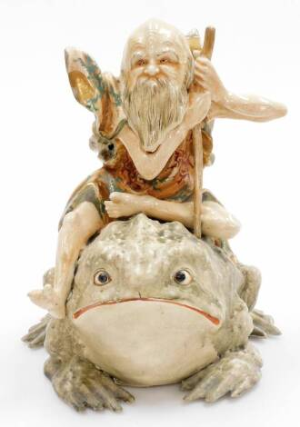 An unusual Japanese Satsuma group of a Gama Sennin seated upon his giant toad, Meiji period. 28cm high.
