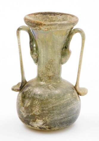 A Roman style glass vase, with trumpet stem and bellied circular body, with elaborate handles, in opalescent colours with rough pontil, 10cm high. (AF)