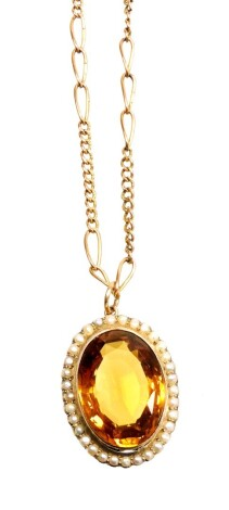 A citrine and seed pearl pendant and chain, the oval pendant with central citrine surrounded by seed pearls each in claw setting, in a yellow metal frame, 3.2cm x 2.5cm, marked 9ct, on a fancy link chain, yellow metal, unmarked, 44cm long overall, 17.6g a
