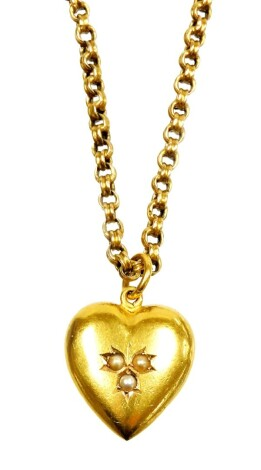 A heart shaped pendant and chain, the heart shaped pendant set with three seed pearls to centre, on single loop drop, marked to back 15c, marked AW, on rounded box link yellow metal chain, marked 375, 46cm long overall, 8.9g all in.