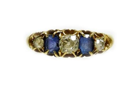 An 18ct gold sapphire and diamond five stone ring, set with three old cut diamonds and two rectangular cut sapphires, the largest diamond approx 0.24cts, the smaller 0.12cts, each in claw setting, ring size M½, 3.3g all in.