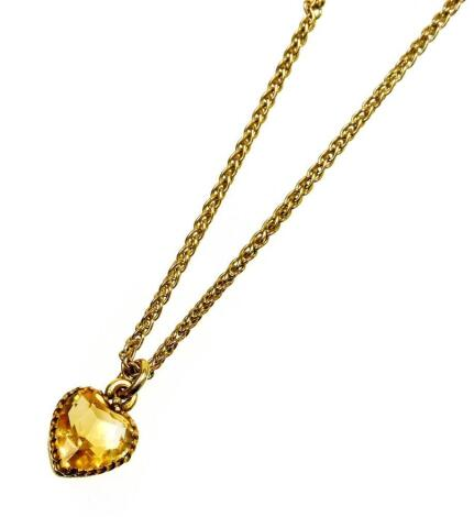 A 9ct gold citrine heart pendant and chain, the heart in yellow metal claw frame on byzantine chain, 38cm long overall, 4.3g all in.