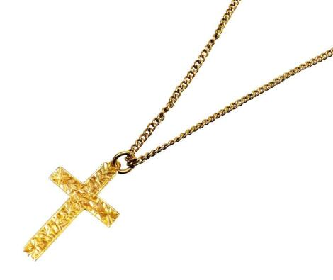 A crucifix pendant and chain, the pendant florally engraved, and marked 9ct, on a fine link chain, yellow metal, unmarked, 42cm long overall, 3.9g all in.