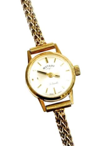 A 9ct gold Rotary ladies wristwatch, with small circular silvered coloured dial, with twenty one jewel movement, on byzantine type strap, 16.5cm long overall, 11g all in, boxed.