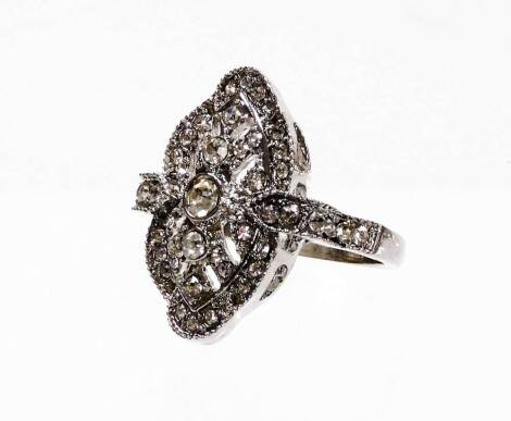 An Art Deco style modern dress ring, set with white paste stones, on modern costume band, ring size U.