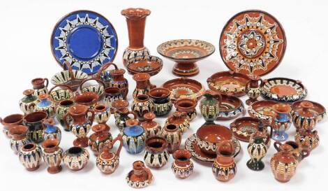 A large collection of Troyan brown earthenware glazed pottery, to include vase, 18cm high, other vases, dishes, plates, baskets, etc., some green glazed, etc. (a quantity)