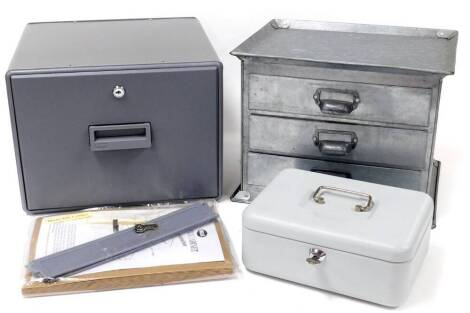 A 20thC metal three drawer table top filing cabinet, with three drawers to the front, 30cm high, 38cm wide, 29cm deep, a modern cash tin, a Helix office desk cabinet, with keys, etc. (a quantity)