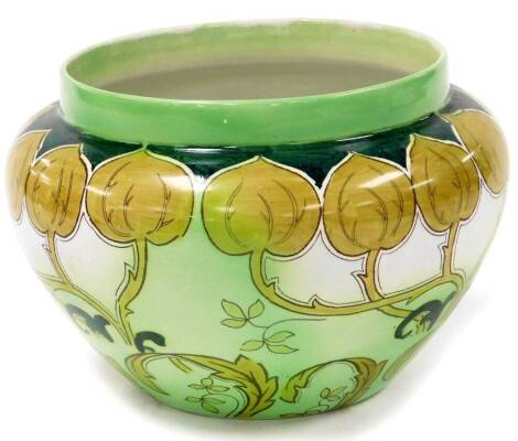 An early 20thC Adderley pottery Art Nouveau secessionist jardiniere, with entwined floral decoration, on a green and white ground, impressed and printed marks beneath, 18cm high.