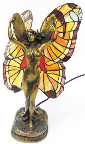A Tiffany style fairy lamp, the figure in standing pose, with decorative glass wings, on a shaped base, 41cm high.