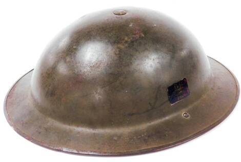 A mid 20thC fire helmet, probably a post WWII Belgian Tommy Brody clone with Belgian flag to interior 32cm x 29cm.