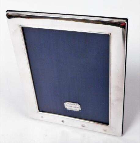 An Elizabeth II silver photograph frame, of plain rectangular design, with wooden easel back, Sheffield 1995, 23cm high, 18cm wide.