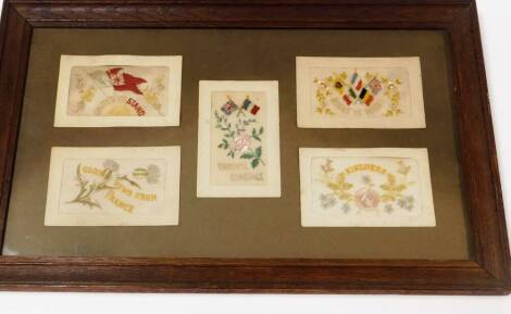 A framed set of early 20thC embroidered postcards, to include Good News From France, other WWI, Kindness, etc., in a glazed frame, 53cm x 34cm.