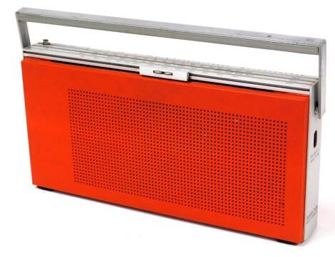 A vintage Bang & Olufsen BZ19 radio, in orange and chrome colours, with swing handle, 35cm wide.