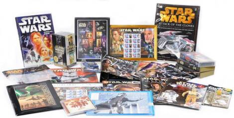 Various Star Wars collectables, Star Wars Trilogy unopened box set, The Official Star Wars Fact File, blister pack stationary set, Official Annual 1999, playing cards, Solo unopened CD, other videos, etc. (a quantity)