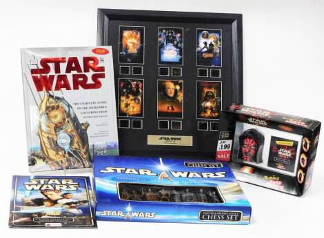 Various Star Wars collectables, a Darth Maul Rubik's cube puzzle, blister pack, film cell, Episode One hardback book, and a chess set, etc. (a quantity)