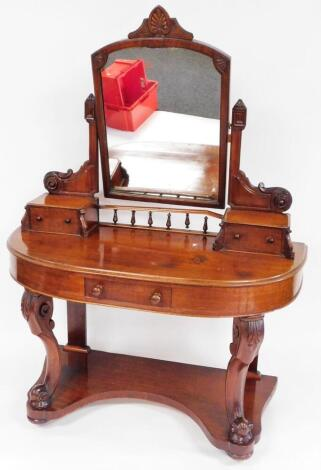A Victorian mahogany Duchess dressing table, the shaped mirror surmounted by a carved leaf, and flanked by shaped scroll and angular supports above two jewel drawers, the demi-lune top with single frieze drawer, on acanthus capped scroll legs joined by a