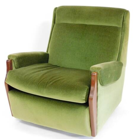 A vintage teak framed armchair, in green material, with shaped supports, 83cm high. The upholstery in this lot does not comply with the 1988 (Fire & Fire Furnishing) Regulations, unless sold to a known exporter or upholsterer it will be cut from the fram
