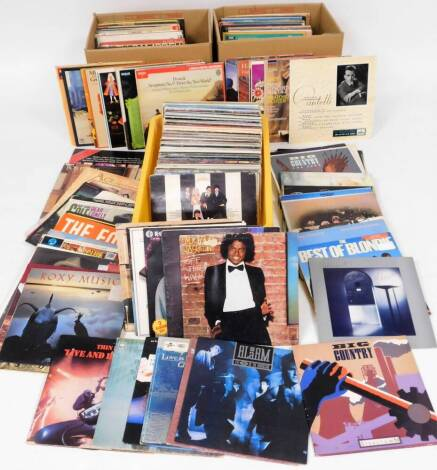 Various records, 33rpm etc., including rock and classical music, Blondie, Blue Oyster Cult, UB40, etc., Rachmanioff, Mozart, various other classical, etc. (a quantity)