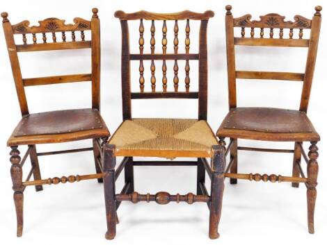 A 19thC Lancashire style elm and rush seated spindle back chair, with ear shaped cresting rail, double spindle back, rush seat and turned front legs, joined by a horizontal front stretcher, 90cm high, and a further pair of country dining chairs, with turn