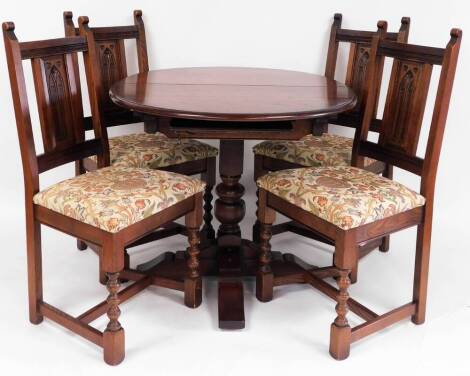 An Old Charm dining suite, comprising extending D-end dining table, 76cm high, 112cm wide, 88cm deep, and four dining chairs, with fixed carved back splats, overstuffed seats and turned front legs, joined by H stretcher.