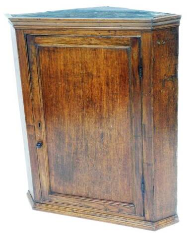 A 19thC oak hanging corner cupboard, with plain panel door and shelves to the interior, on a moulded base, 96cm high, 81cm wide, 61cm deep.